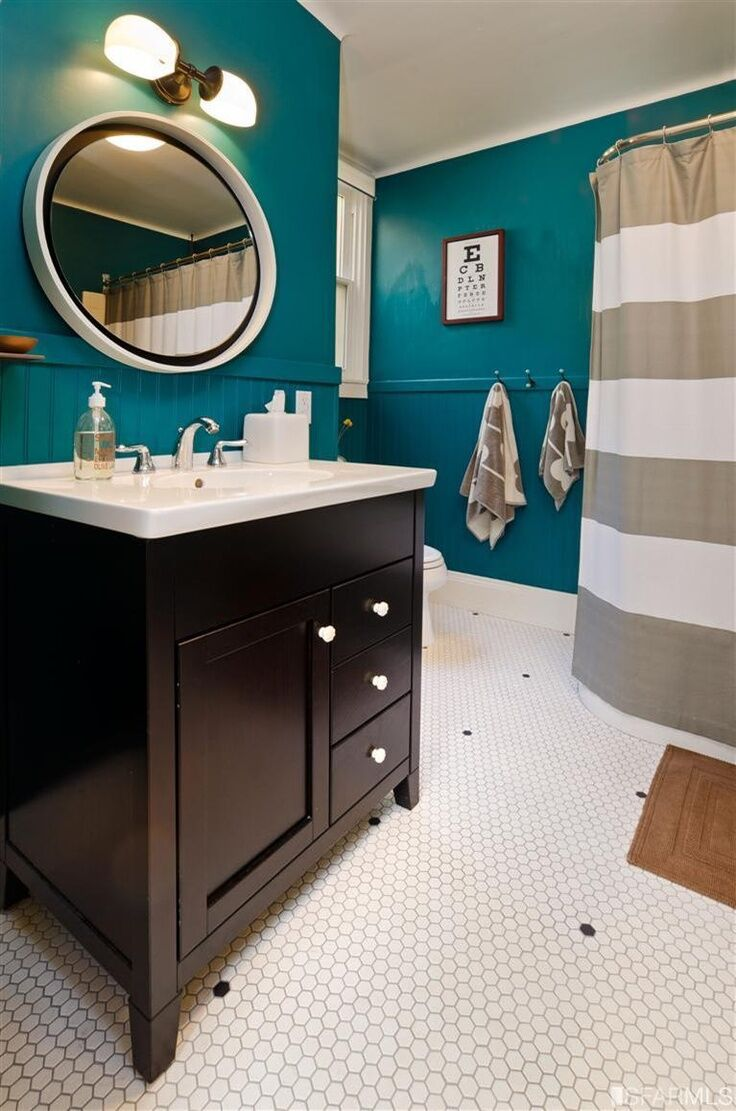 Luxurious teal for Dark walls white furniture